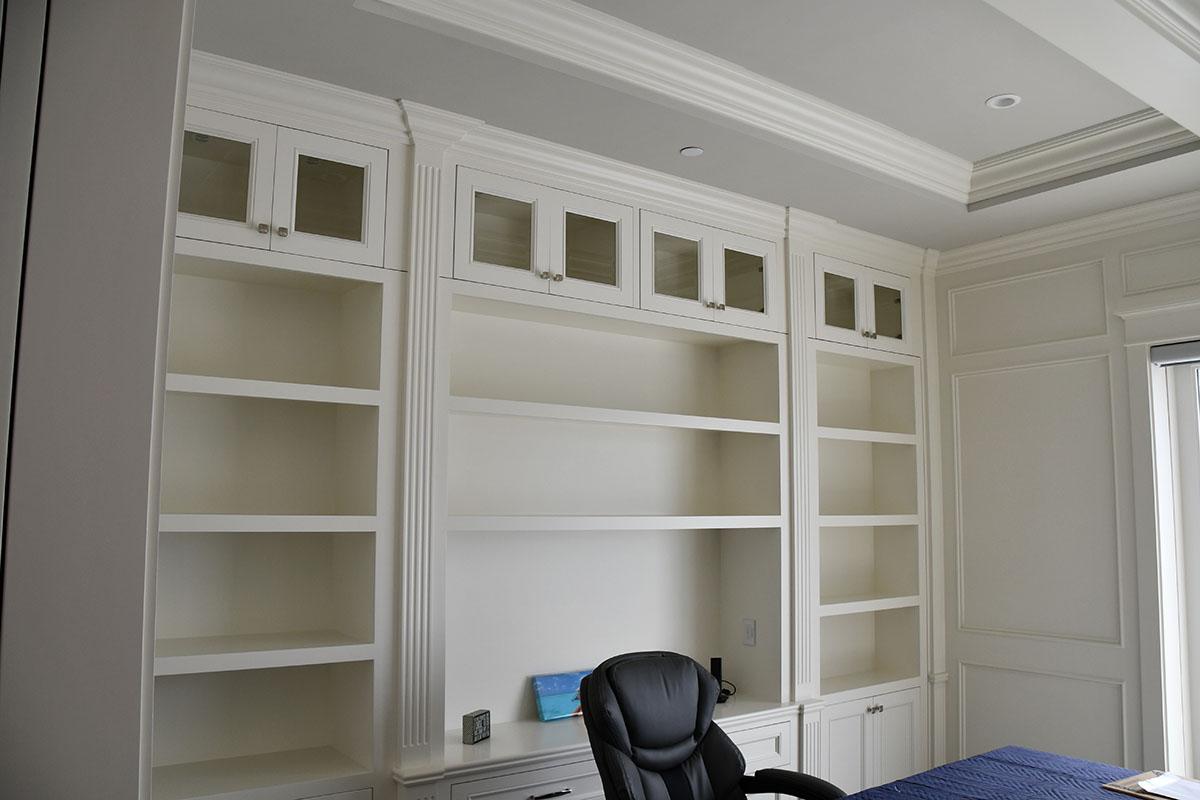 white shelves behind desk